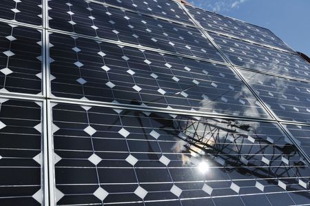 Solar Panel with Reflection of Wind Turbine and Sun photo
