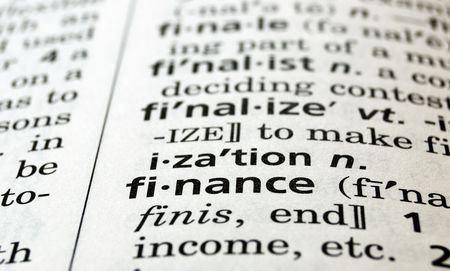 underwrite: The word finance in a dictionary, close-up
