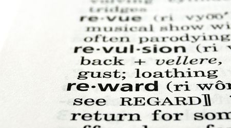 The word reward in a dictionary, close-up