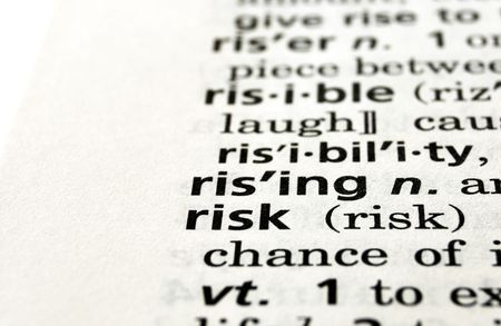 peril: The word risk in a dictionary, close-up