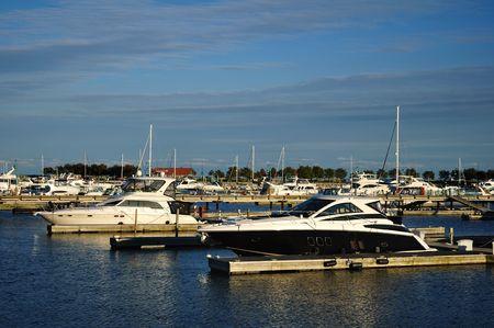 speedboats: Cabin Cruiser Yachts Docked at a Lakeside Marina Stock Photo