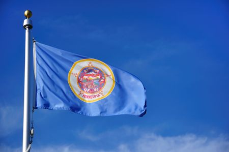 Minnesota State Flag Against a Blue Sky