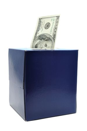 devaluation: One Hundred Dollar Bill in Tissue Box Isolated on White, could symbolize devaluation of the dollar or inflation