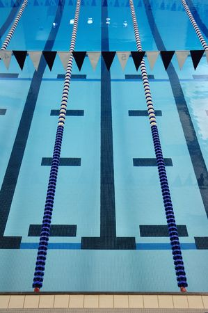 lane lines: Indoor Swimming Pool with Lane Lines and Backstroke Flags Stock Photo