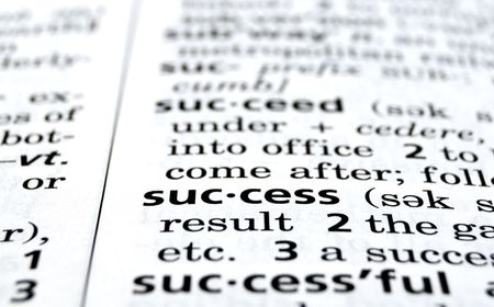 definition define: Close-up of the word Success in a dictionary