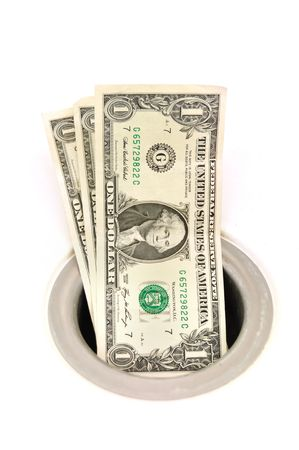 Money Down the Drain Isolated on White photo
