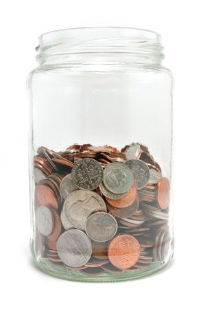 half cent: Jar Half Full of Coins Isolated on a White Background