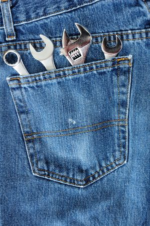 crescent wrench: Close-up of Four Wrenches in Blue Jean Pocket
