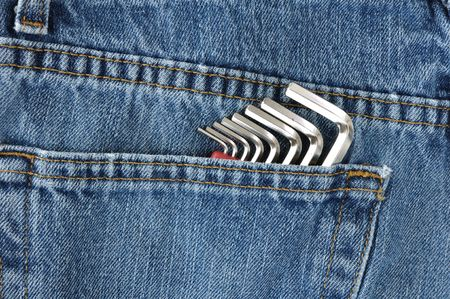 Close-up of Hex Key Wrenches in Blue Jeans Pocket photo