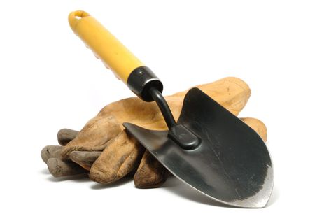 Old Dirty Leather Work Gloves and Trowel Isolated On White Stock Photo