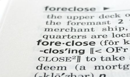foreclose: Close-up of the word foreclose in a dictionary