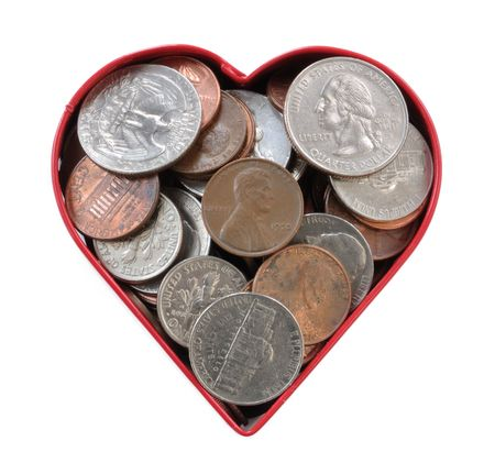 Coins in a Heart Shaped Cookie Cutter photo