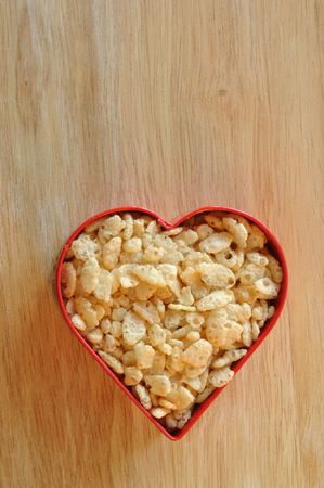 wood cutter: Crispy Rice Cereal in Heart Shaped Cookie Cutter