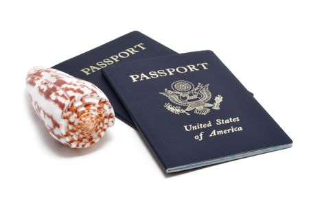 Two United States of America Passports and a Seashell Stock Photo - 6487983