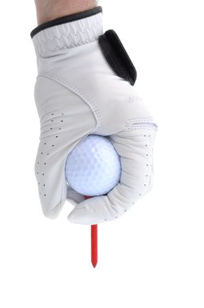 white glove: Golfer Wearing Golf Glove Teeing Up a Golf Ball on a Red Tee Stock Photo