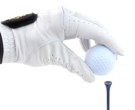 Golfer Wearing Golf Glove Teeing Up a Golf Ball on a Red Tee Reklamní fotografie