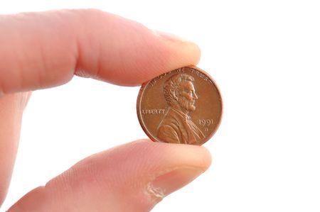 白で隔離されるリンカーン セント硬貨のクローズ アップ