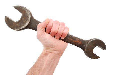 Grote open sleutel in de Hand te houden geïsoleerd op wit Stockfoto