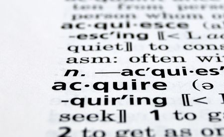 acquire: Close-up of the word Acquire in a dictionary