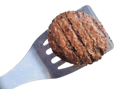 spatula: Grilled Hamburger Patty on a Spatula Isolated on White