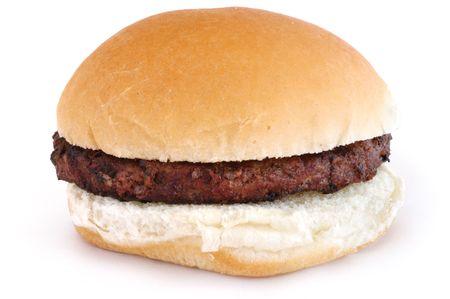 白で隔離されるパンの上のグリルのハンバーガー 写真素材