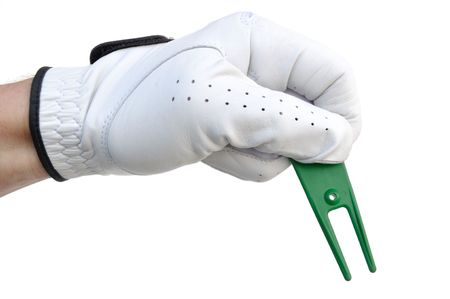 Golfer Holding a Green Ball Mark Repair Tool (or Pitchfork) photo