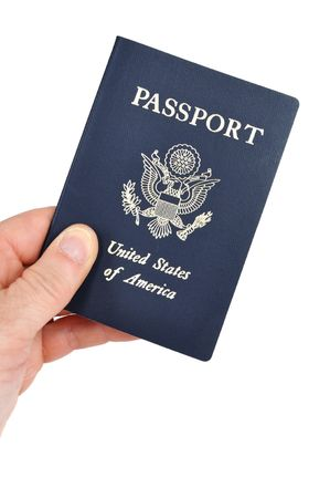 Hand Holding an American Passport Isolated on White photo