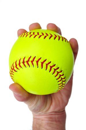 grip: Player Gripping a Yellow Softball Isolated on White