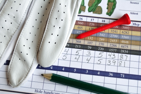 점수: Close up of Golf Score Card with Glove, Pencil, & Tee