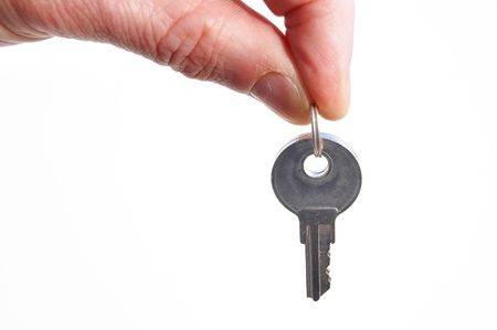 Hand Holding Keys Isolated on a White Background