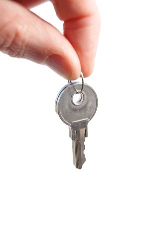grasp: Hand Holding Keys Isolated on a White Background