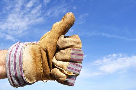 Werknemer lederen werk handschoen geven de duimen omhoog teken dragen Stockfoto