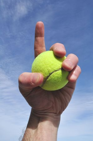 forefinger: Player Gripping a Yellow Tennis Ball Doing Number One Sign Stock Photo