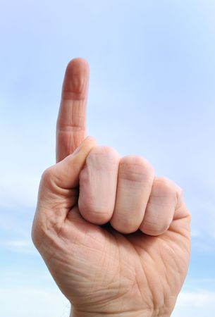 Number One Hand Gesture Against a Blue Sky Stock Photo - 6790079