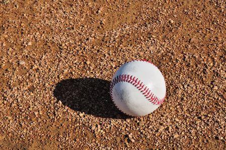 White Baseball on the Infield Dirt Stock Photo - 6906658