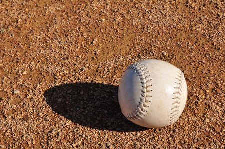White Softball on the Infield Dirt Stock Photo - 6911792