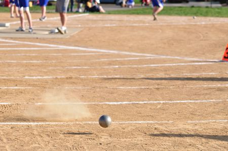 Shot Put Landing on Dirt Field Stock Photo - 6911787