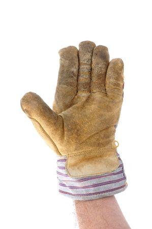 Werknemer dragen lederen werk hand schoen geven stoppen gebaar of zwaaien