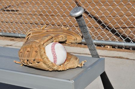 Baseball, Bat, and Glove on an Aluminum Bench photo