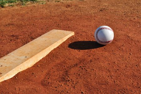 rubber: Baseball on the Pitchers Mound Near the Pitching Rubber