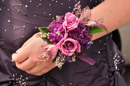 Purple and Pink Flowers (Roses) on Wrist Corsage for Prom Stock Photo