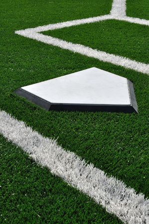 Home Plate on Baseball Field with Artificial Turf photo