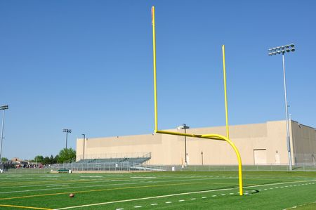 Yellow Goal Posts on American Football Field Banco de Imagens