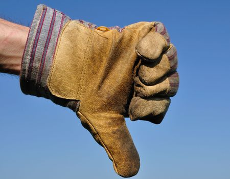 disapprove: Worker Wearing Leather Work Glove Giving the Thumbs Down Sign