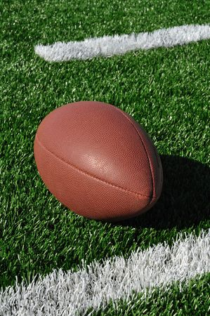 Football near Hash Marks on Artificial Turf photo