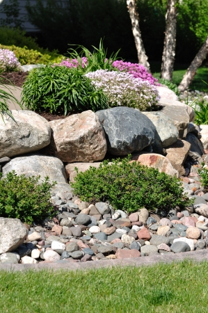 retaining: Stone Retaining Wall with Flowers and Shrubs