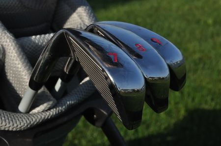 7 8: Close up of 7, 8, & 9 Irons (Clubs) in a Golf Bag