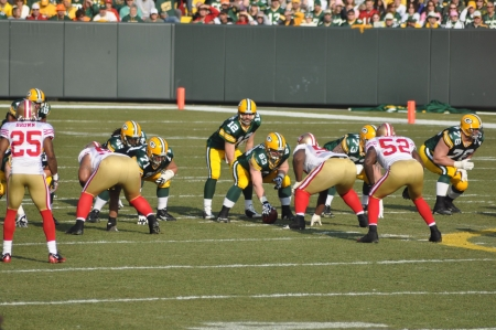 GREEN BAY, WI, NOVEMBER 22, 2009: Green Bay Packers quarterback Aaron Rodgers prepares to take the snap in a game at Lambeau Field against the San Francisco 49ers