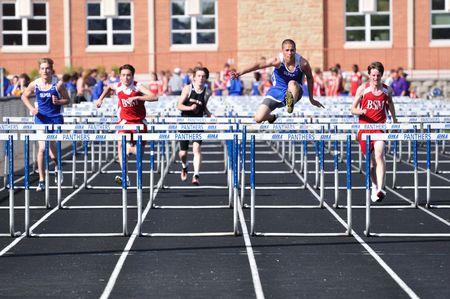 SPRING LAKE PARK, MN - APRIL 20: High school boys hurdles race April 20, 2010 in Spring Lake Park, Minnesota.