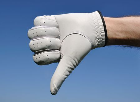 disapprove: Golfer Wearing Golf Glove Giving Thumbs Down Sign